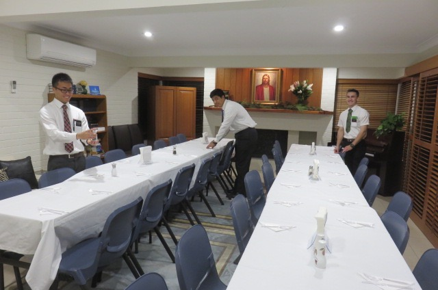 Setting up for Dinner on Saturday Night. Elder Sunagawa, Elder Keliliki, and Elder Butterfield.