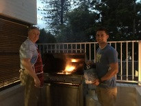 President and Elder Butterfield flipping the Burgers! yum!