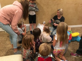 Grandkids getting their special gift from Aunt Ash