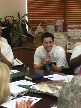 Singing to him, Elder Pugsley